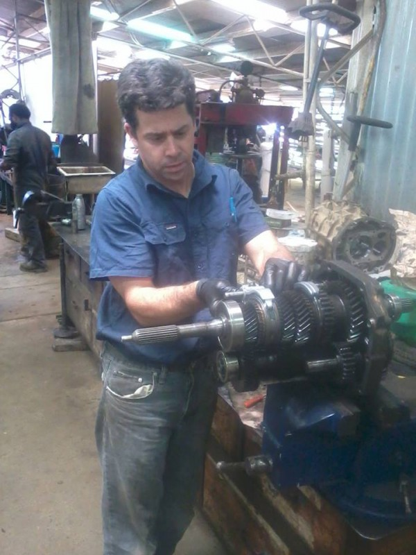 "Jeremy Lott contacted us via our Facebook page and attached of picture of himself working in the shop at Ukarumpa SIL, Papua New Guinia. This is one reason we keep our Facebook privacy settings on ""Global"""